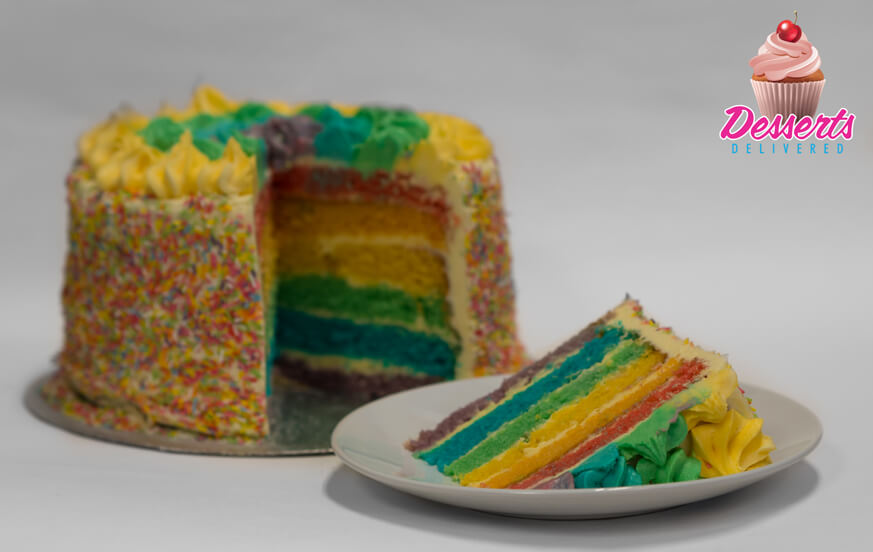 Rainbow sponge with multi colored icing